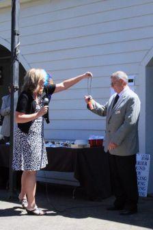 "John and Michele Goosen with the mic,  ""Happy 65th Birthday John"""